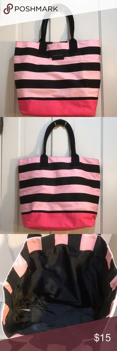 Victoria Secret weekender tote bag Victoria Secret weekender tote bag. Holds a decent amount of clothes for a weekend trip! Also makes a great beach bag!! Victoria's Secret Bags Travel Bags