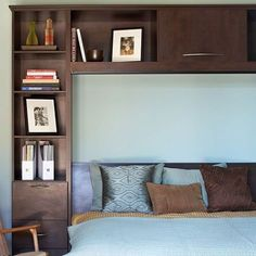 Frame your bed with custom cubbies, forming in the process a headboard in reverse.