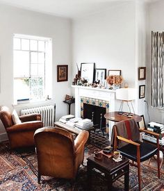 The Coziest Rooms On Instagram #refinery29  http://www.refinery29.com/cozy-winter-room-decor-instagram-pictures#slide-1  Leather chairs and mismatched oriental rugs make this fireplace a cozy place to curl up with a good book....