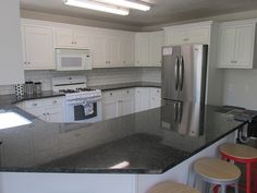 Kitchen makeover. From partial overlay to inset. - 4 Men 1 Lady-- after