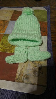 Spring green baby hat and boots with a matching dress. 2d3ea343445