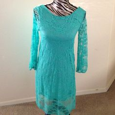 ✨Final Sale✨ lace dress with teal liner NWOT See through lace sleeves, with bow in the back. Super cute. Never been worn. Pretty teal color. Good party dress. Dresses Midi