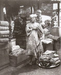 "Yoruba adire seller at market in Ibadan, Nigeria in Photo from ""Nigerian Artistry"" by Pat Oyelola. African Culture, African History, African Art, Tribes Of The World, Yoruba People, African Textiles, Weaving Art, African Beauty, West Africa"