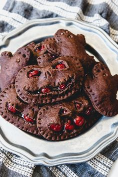 Halloween Chocolate Cherry Hand Pies are an easy and fun treat with a chocolate pastry crust cut out in Jack-O-Lantern shapes and canned cherry pie filling! recipes for halloween Halloween Treats For Kids, Halloween Sweets, Halloween Chocolate, Healthy Halloween, Halloween Dinner, Halloween Cupcakes, Halloween Foods, Halloween Deserts Recipes, Halloween Horror