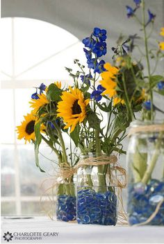 centerpieces- do this with red, white, and blue beans. daisies?  put burlap on tables scatter Shelby's blue rose petals on burlap. red check ribbon with the twine?