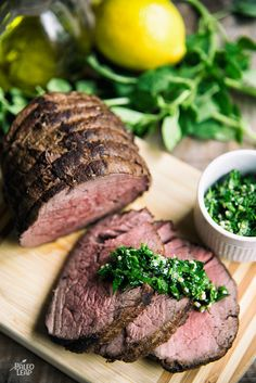 A glazed beef tenderloin roast served with a fresh, zesty herb sauce and ready in less than an hour.