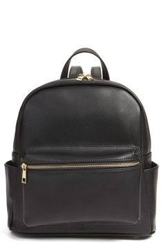Perfect for the girl on the go, this diminutive structured backpack is fashioned from sleek faux leather in a campus-classic style and upgraded with golden hardware for a little extra shine.