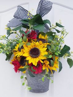It's unbelievable!  Try these 11 suggestions all relating to #frontdoorspaint Indoor Wreath, Outdoor Wreaths, Faux Flowers, Colorful Flowers, Sunflower Arrangements, Red Sunflowers, Modern Wreath, Modern Nursery Decor, Greenery Wreath