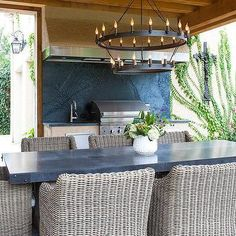 Zinc Outdoor Dining Table with Wicker Dining Chairs