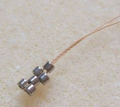 clever way to start a bezel ~ Seed Bead Tutorials