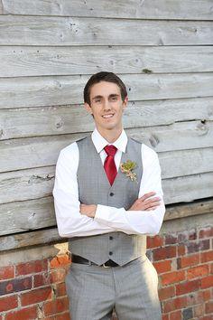 groom in grey and white with red tie #groom #groomattire #weddingchicks http://www.weddingchicks.com/2014/02/10/i-heart-fall-wedding-inspiration/