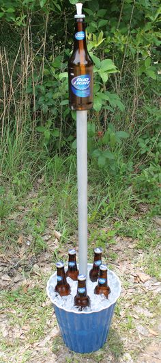 Redneck Tiki Torch/Beer Cooler Combo...can also can fill bottom with sand to use as butt can, or potting soil to use as planter.