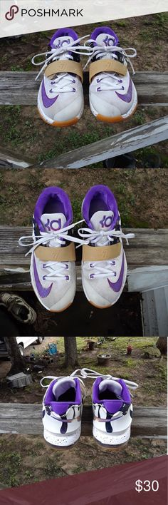 Nike Kd Girls Shoe's size 6 This is a used pair of Nike Kd Girls Shoe's size youth, they are white, purple, pink and tan. They have Velcro and shoe strings. There is some scuff marks on the Shoe's. There are no holes or tears on either shoe. Please view the pictures and if you have any questions please ask. Nike Kd Shoes Sneakers