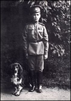 Alexei and his dog Joy - a photograph taken by the Tsaritsa in 1916 and released for war charities
