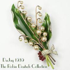 Rare DuJay Enamel Lily 1939. Magnificent very large DuJay enamel, faux pearl and faux ruby lily of the valley. The Robin Deutsch Collection