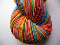 Hand Dyed Yummy Merino/Nylon Fingering Weight Yarn- Rainbow Fruit Chews. $20.00, via Etsy.