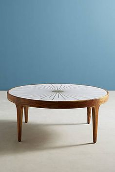 Brass Starburst Coffee Table - I really like this one, but I think it may not be substancial enough to conrast wtih the sofa