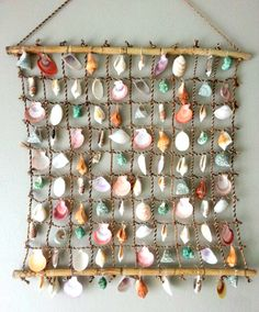 Wall hanging with shells from the beach. Wall hanging with shells from the beach. Wall hanging with shells from the beach. Seashell Art, Seashell Crafts, Beach Crafts, Diy And Crafts, Arts And Crafts, Seashell Display, Crafts With Seashells, Seashell Decorations, Seashell Mobile
