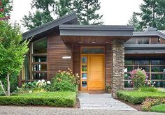 Ultra-Contemporary Knockout - 69113AM | Contemporary, Northwest, Luxury, Photo Gallery, Premium Collection, 1st Floor Master Suite, Butler Walk-in Pantry, CAD Available, Den-Office-Library-Study, Media-Game-Home Theater, PDF, Sloping Lot | Architectural Designs