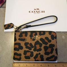 Coach Ocelot wristlet new with tags never used Coach Ocelot wristlet new with tags never used Coach Bags Clutches & Wristlets