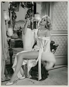 """THE CARPETBAGGERS - Carol Baker as blonde bombshell """"Rena Marlowe"""" - Based on the novel by Harold Robbins - Paramount Pictures - Publicity Still."""