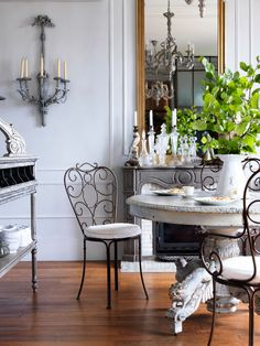 """""""Café chairs or wooden tables look just as great in a kitchen as they do on the patio,"""" says Erin Swift, author of """"French Accents: At Home with Parisian Objects and Details."""" The overall feeling—as with these art nouveau wrought-iron dining chairs—is unexpected and brings a bit of the Parisian café indoors."""