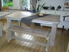 White washed table made from scaffolding wood
