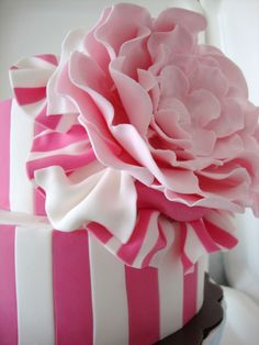 A pink stripe cake with a Camellia!!!! This is a Southern cake...My Mother was the Camellia Queen (I couldn't make that up)! I have to figure out how to have this made for her big birthday coming up. Adorable!