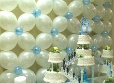 """A splendid backdrop Made of """"Quick Link"""" Balloons. To find out how it's made, go to http://www.balloon-decoration-guide.com/how-do-i-make-a-balloon-flower-wall.html."""