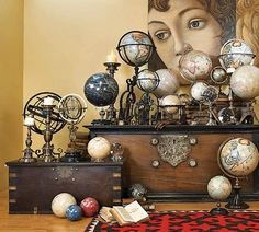 Vintage relics, such as these maps and globes, bring interest and chic style to a home's decor.