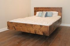Monarch Platform Bed - Hovering above the floor this platform bed with captivate the eye and bring rest to the body. A character-filled planked style headboard stands out above a flush-mount base. No box-spring is required for this intricately crafted bed.