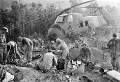 In this Sept. 21, 1966 file photo, U.S. Marines emerge from their muddy foxholes at sunrise after a third night of fighting against continued attacks of north Vietnamese 324 B division troops during the Vietnam War.