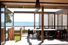 Holiday house (Bach) Waiheke Island, NZ. Deck with shutters.
