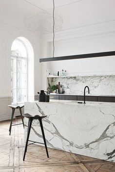 Read on for everything you need to know about marble kitchen sinks. You want to make sure that you are fully aware of all the pros and cons before making a decision that will impact your kitchen remodel and your bottom line. #hunkerhome #marblekitchen #marblekitchensinkideas #sinkideas #kitchensinkideas