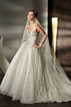 Beaded Sparkling tulle Strapless with a Basque waist full A-line skirt Lace-up back and attached train