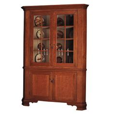 Pennsylvania Corner Cupboard • Reproduction Cupboards •Martin's Chair •Available in Cherry, Curly Maple, Maple and Poplar • Height: 82 in • Width: 40 in