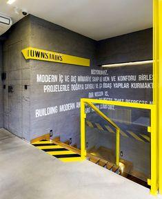Black and Yellow Emre Group Office Interior - InteriorZine