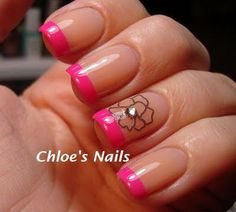 Hot pink tips, flower nail tattoo and a rhinestone