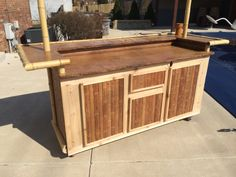 Storage On Indoor/outdoor Tiki Bar Made By Custom Outdoor Structures. Wheels  Make The