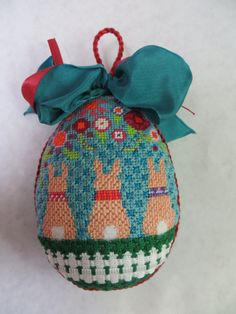 Three bunnies, egg shaped ornament stitched by Mina C.