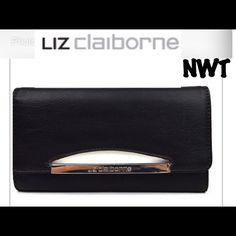 """NWT• Liz Claiborne• Luna Wallet Black & white• Carry your currency with sleek style in this wallet featuring contrast colors. snap closure synthetic; synthetic lining metal logo plate interior zip compartment, 12 credit card slots, 2 slip compartments and ID window 4(H)  x 7½(W) x 1¼""""(D) imported Liz Claiborne Bags Wallets"""