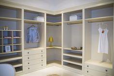 Image from http://www.tegrewardrobes.com/img/cream_slidingdoor/walk_in_wardrobe.jpg.
