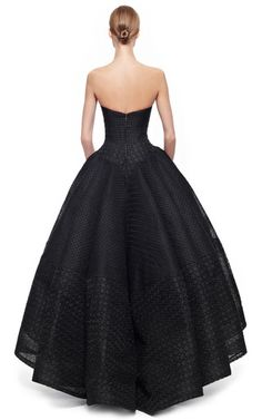 This strapless embroidered organza Zac Posen gown features a bustier-styled boned bodice with a notched sweetheart neckline, an A-line waist and a pleated full skirt with an exaggerated stepped hem.Hidden zip back closure80% polyester, 20% cottonFully linedMade in USAPlease note: This item may be returned for M'O credits or full refund.