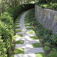 Rectangular stone pavers in alternating pattern.