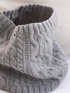 Ravelry: Cable-eazy Cowl pattern by Megan Delorme matches the Greystone 2 hat I think