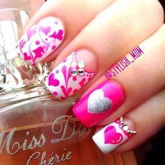 .pretty pink nails w/ heart designs (: