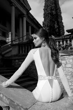 A tantalizing deep V-style open back and a striking lace appliqued belt adorns this gorgeous Berta wedding gown | See more here: Berta Bridal Couture 2014 Winter Collection | Confetti Daydreams ♥  ♥  ♥ LIKE US ON FB: www.facebook.com/confettidaydreams  ♥  ♥  ♥ #Wedding #WeddingDress #WeddingGown @Roberta Causarano Cruz