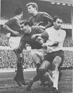 18th February 1967. Spurs forward Alan Gilzean crowded out by Portsmouth's Derek Harris, Vincent Radcliffe and goalkeeper Albert Milkins, in an FA Cup tie, at White Hart Lane.