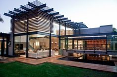 Nico van der Meulen Architects have designed the House Aboobaker in Limpopo, South Africa. - Front