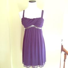 Purple formal dress Flowy dress.  Has sequences under the chest. Toes in the back. Only worn once Joyce Leslie Dresses